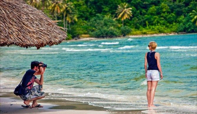 A couple is enjoying their honeymoon at Nha Trang Beach, Vietnam